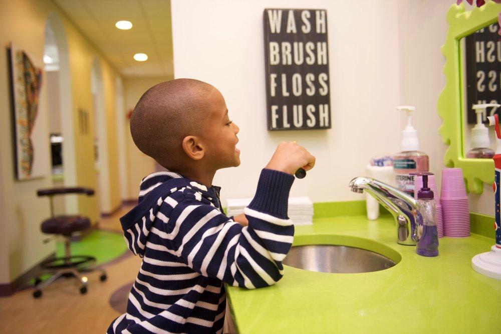 boy at brush sink 1