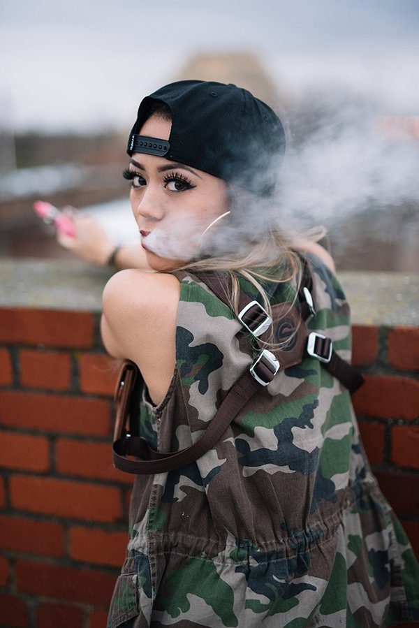 Vaping teen girl posts vaping to social media accounts