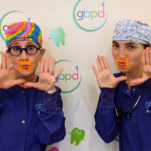 pediatric dentists dr. laura adelman and dr. rachel rosen post with organ lip tape for training nasal breathing