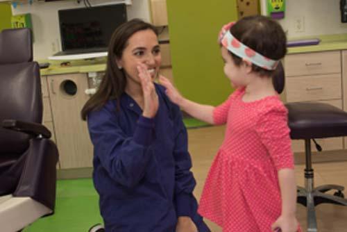 Dr. Rachel Rosen High Fives Toddler After First Dental Visit 1 300x281 1