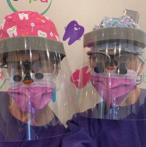 Twinsburg pediatric dentists Dr. Rachel Rosen and Dr. Laura Adelman in full PPE gear