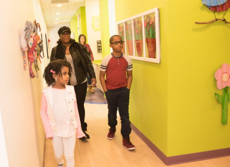 family walks through colorful Twinsburg pediatric dental office Great Beginnings Pediatric Dentistry